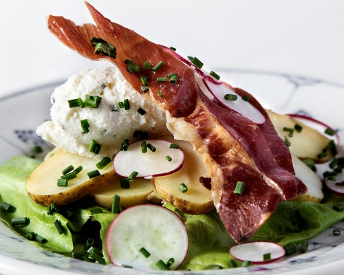 Our Head Chef, Jimmi Bengtsson, celebrates the arrival of the new crop of Danish potatoes – and summertime - by composing some mouth-watering open-faced sandwiches, like potatoes with smoked salmon and herb crème, with 'granny salad' and deep-fried anchovies or with oven-baked ham and crème of smoked cheese (pictured).