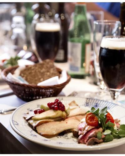 """Truly an outstanding lunch"" writes Emilie Bjørnsen, who had invited seven selected elite bloggers from Yelp.dk for a Danish lunch with open-faced sandwiches with a twist, artisan beers from Nørrebro Bryghus and Sherry Aquavit at Restaurant Kronborg. Photo by Chris Tonnesen"