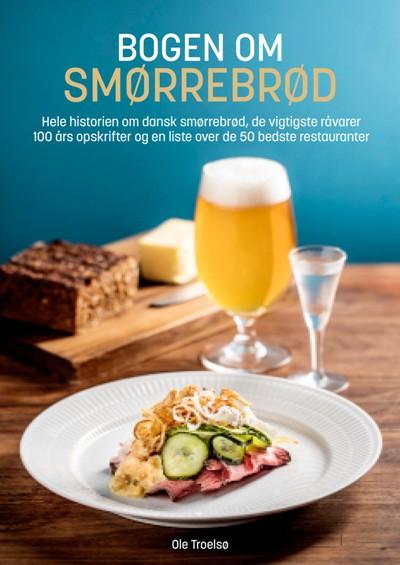 """""""Det er en god tid for smørrebrød,"""" skriver Ole Troelsø i sin nye bog """"Bogen om smørrebrød"""". Vi er glade og stolte over at være med på Ole Troelsøs Top-10 liste over landets bedste smørrebrødsrestauranter"""